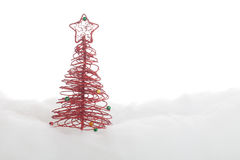 Symbolic Christmas tree in the snow Royalty Free Stock Images