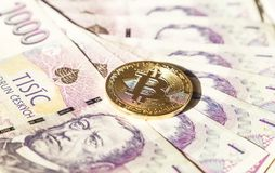 Bitcoin on banknotes of czech crowns. Symbolic coins of bitcoin on banknotes of czech crowns Stock Photo
