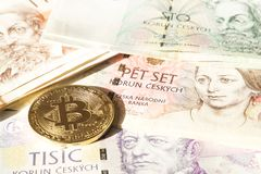 Bitcoin on banknotes of czech crowns. Symbolic coins of bitcoin on banknotes of czech crowns Royalty Free Stock Images