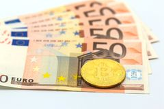 A symbolic coins of bitcoin on banknotes 50 Euro background. business concept.  Stock Images