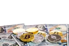 Symbolic coins of bitcoin on banknotes of one hundred dollars. royalty free stock images