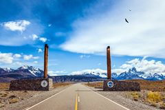 Symbolic columns to grandiose Mount Fitz Roy. Symbolic columns on the road to Los Glaciares National Park. Fine highway to the grandiose Mount Fitz Roy Stock Image