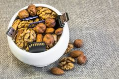 Symbolic composition of nuts and memory cards. Composition of nuts and memory cards. Symbolizes the useful properties of nuts to improve human memory stock photos