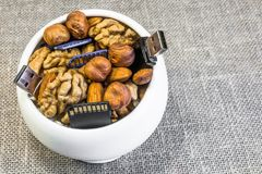 Symbolic composition of nuts and memory cards. Composition of nuts and memory cards. Symbolizes the useful properties of nuts to improve human memory stock photography