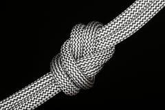 Symbolic diagonal knot Stock Image