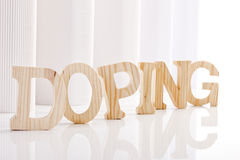 Symbolic for doping: Wooden letters Royalty Free Stock Photo