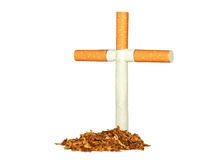 Symbolic grave of tobacco. And a cross of cigarettes Stock Photography