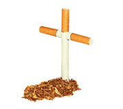 Symbolic grave of tobacco. And a cross of cigarettes Royalty Free Stock Images