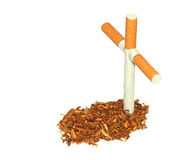 Symbolic grave of tobacco. And a cross of cigarettes isolated on white background Stock Image