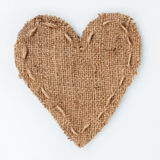 Symbolic heart of burlap lies on a white background Royalty Free Stock Photography