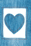 Symbolic heart and frame made of jeans Royalty Free Stock Photo