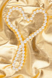 Symbolic heart on a gold  fabric Royalty Free Stock Image