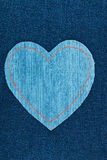 Symbolic heart made of jeans lying on dark jeans Stock Photo