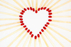 Symbolic heart with matches Royalty Free Stock Images