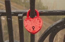 Symbolic hearts attached to a metal chain stock photo