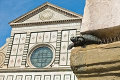 Symbolic heraldry details on a church at downtown of Florence in Tuscany. Italy royalty free stock photo