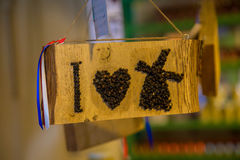 """The symbolic image of. """"I love the Netherlands"""" - the word """"I"""", the heart and the mill, writing with dried berries Royalty Free Stock Images"""