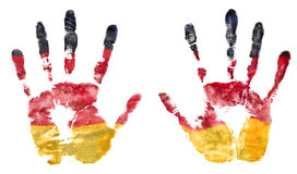 Symbolic imprint of two open hands of paint flag of Germany Royalty Free Stock Photo