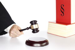 Symbolic justice. Man with wooden gavel and book, justice symbol Stock Photo