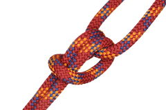 Symbolic knot with red rope Royalty Free Stock Photo