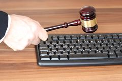 Symbolic law with media symbol. On a desk Royalty Free Stock Image