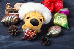 Symbolic little Christmas dog Stock Images