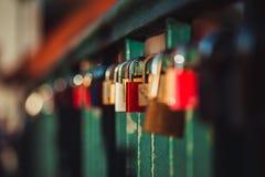 Symbolic Love, fixed padlocks on bridge. Padlocks fixed to the railings of bridge, Berlin, Germany. Shallow depth of field and creamy bokeh Royalty Free Stock Images