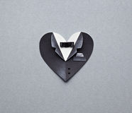 Symbolic male heart shape on gray paper background Stock Photography