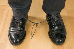 Symbolic of mobbing. A business man with knotted laces, symbolic of mobbing Royalty Free Stock Photography