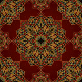 Symbolic pattern of mandalas. Seamless pattern of symbolic mandala on a red background. Colorful oriental ornament. Template for carpet, shawl, wallpaper Royalty Free Stock Photo