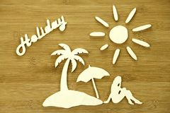 Symbolic representation of vacation. And holidays with wooden elements Royalty Free Stock Images