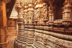 Symbolic sculptures and reliefs in Indian temple wall. Ancient architecture example with Hindu and Jain motifs, India. Stock Photos