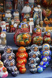 Symbolic souvenirs of Russian culture on sale. Russian souvenirs on street sale in Saint-Petersburg: decorative dolls, eggs, Santa Claus, Ded Moroz royalty free stock photos