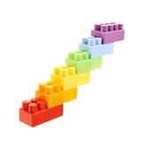 Symbolic stairway made of toy bricks. Symbolic stairway made of six colorful plastic toy construction bricks, isolated over the white background Stock Images