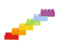 Symbolic stairway made of toy bricks. Symbolic stairway made of six colorful plastic toy construction bricks, isolated over the white background Stock Photos