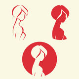 Symbolic woman faces and heads. Logo vector Royalty Free Stock Images