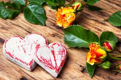 Symbolic wooden heart and flowers Stock Image
