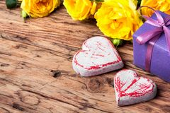 Symbolic wooden heart and flowers Royalty Free Stock Photo