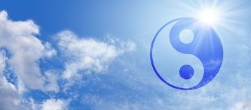 Symbolic Yin Yang on Blue Sky Banner Royalty Free Stock Image