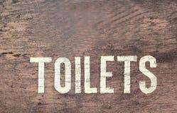 Symboliseer toiletten op de houten vloer stock foto's