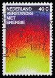 Symbolisera värmeutstrålning, serie för energibeskydd, circa 1977 royaltyfria bilder