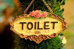 Symbolize toilets on wood background Royalty Free Stock Image