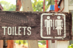 Symbolize  toilets on the wooden floor. Symbolize  toilets on the wooden floor Royalty Free Stock Photography