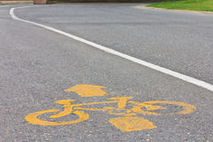 Symbolize yellow bicycle. On the paved bike path stock photos