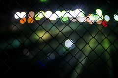 Symbolizes our dreams behind the barrier of our consciousness. Boke behind the wire mesh symbolizes our dreams behind the barrier of our consciousness stock illustration