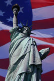 Symbols of america. The symbols of america; the statue of liberty and the american flag royalty free stock photography