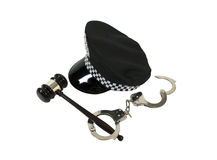 Symbols of Authority. Shown by a black police hat with a set of handcuffs and a wooden gavel - path included royalty free stock photo