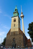 Symbols of Berlin - Berlin TV Tower Fernsehturm and Marienkirche St. Mary`s Church. Royalty Free Stock Photos