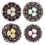 Symbols of bird nests with eggs, vector  Royalty Free Stock Image