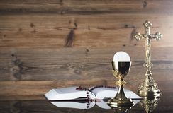 Catholic religion theme - Holy communion concept. Symbols of Christianity religion, brown wooden background. Place for text Royalty Free Stock Photos
